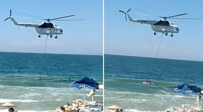 Yangın söndürme helikopteri sahildeki vatandaşlara zor anlar yaşattı